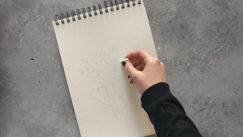 Das Motiv mit Bleistift vorzeichnen und leicht wegradieren