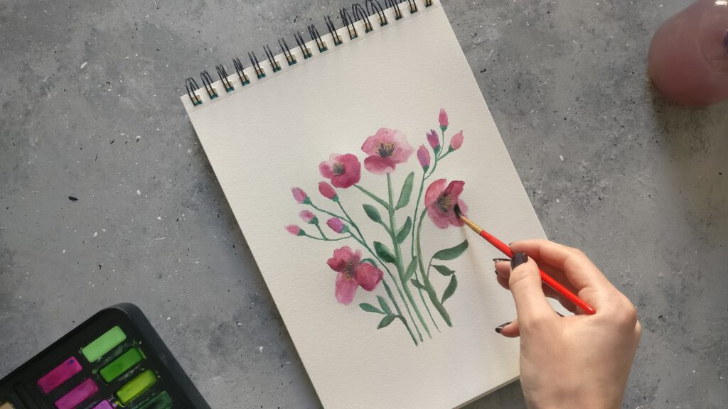 Mit den Wasserfarben die Blumen ausmalen